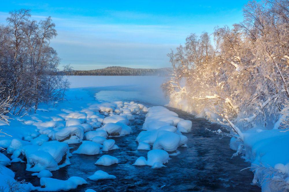 Lac en Laponie lors d'un voyage Photo aurores boréales