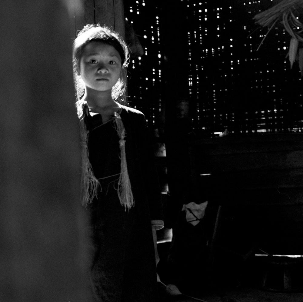 Jeune femme au Laos lors d'un voyage photo